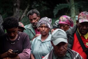 Addressing masculine culture in Papua New Guinea and understanding whether the hybrid judicial system protects women's rights.